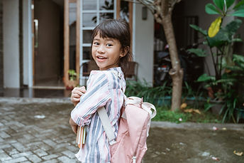 kid-smiling-camera-before-going-school_8