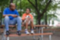 Mentoring Sitting on Picnic Bench 865378