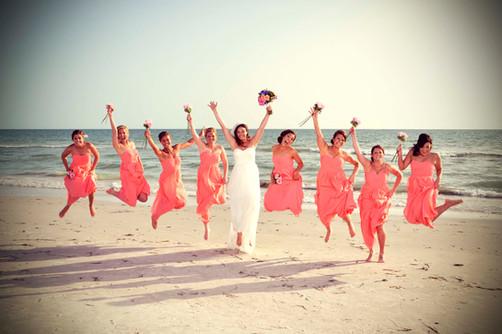 Girls jum on the beach