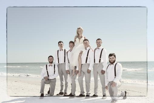Sydney & groomsmen on beach at the Don
