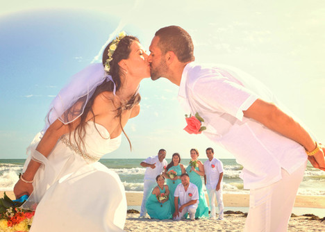 Framing the bridal party on beach