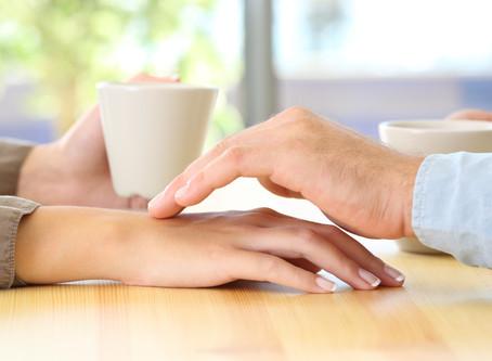 Käden kosketus
