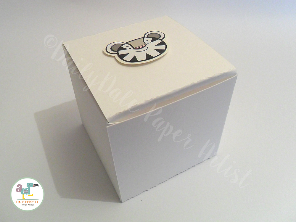 A handmade gift box featuring the Winter Olympic mascot.