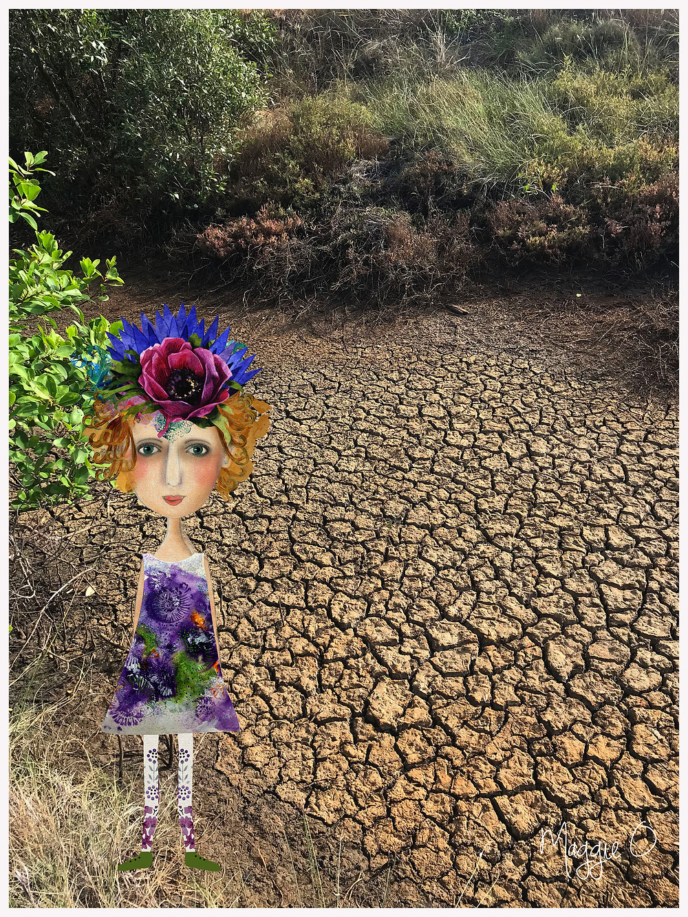 Elly Rose standing on cracked mud
