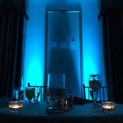 Blue uplighting behind bride/groom