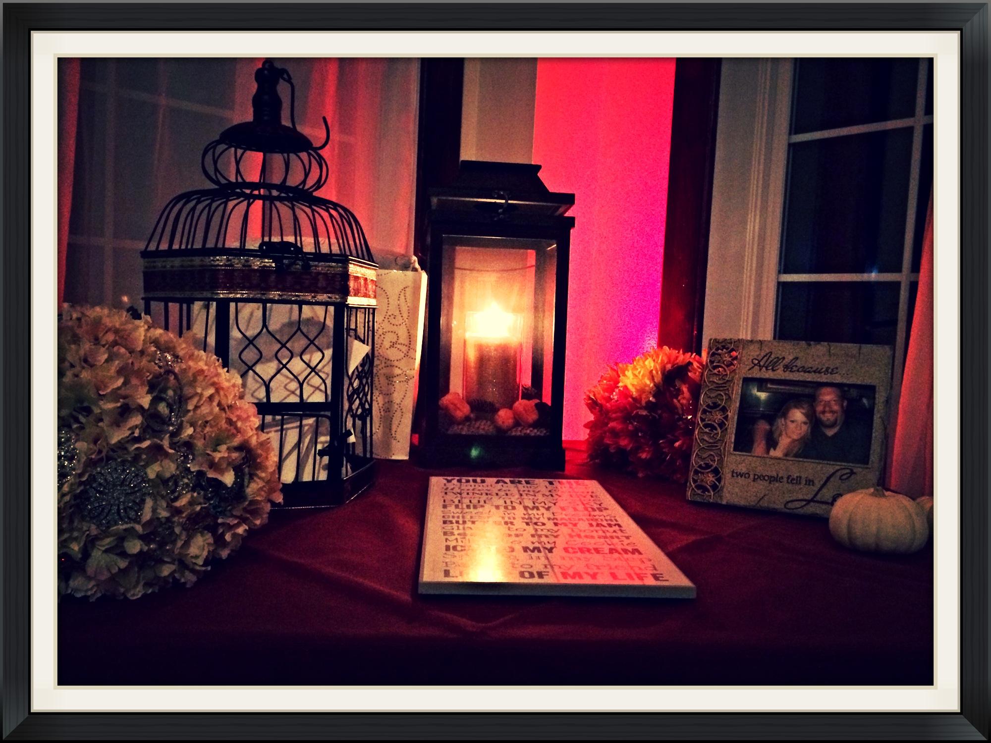 pink uplight behing card table