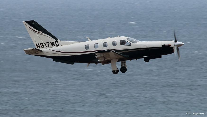 TBM - N317WC (takeoff).jpg