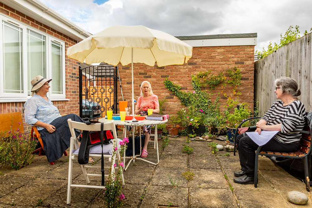 The Histon Rd: A Community Remembers committee taking advantage of the improved weather to hold an outdoor meeting.