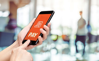 Hand holding mobile with pay word and bi