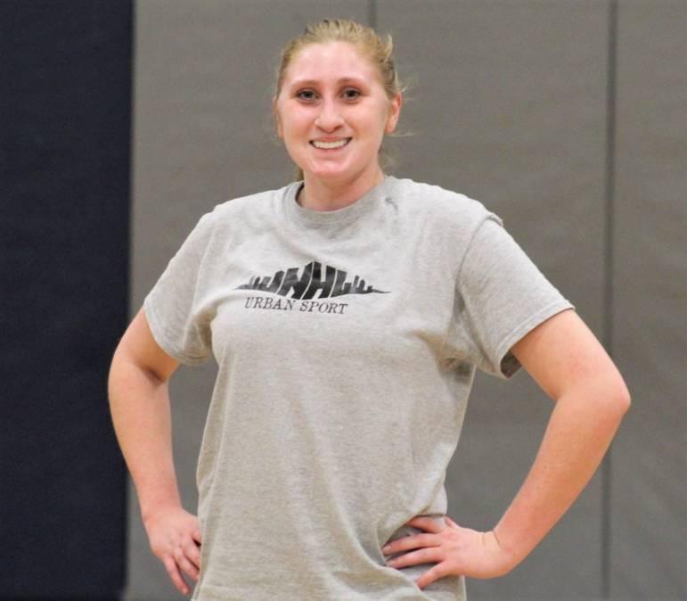 Amanda Charlotte smiling for the camera during NHUS Coed Basketball game