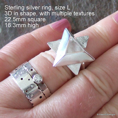 Geometric and sculptural dress ring