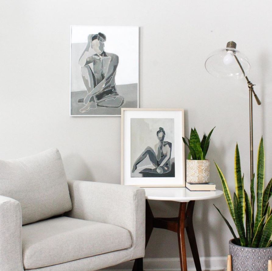 two of Ella's portrait paintings are in an elegant interior scene