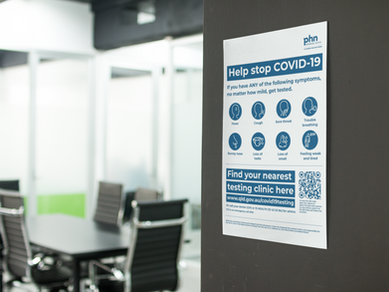 mockup-of-a-poster-on-a-black-wall-near-