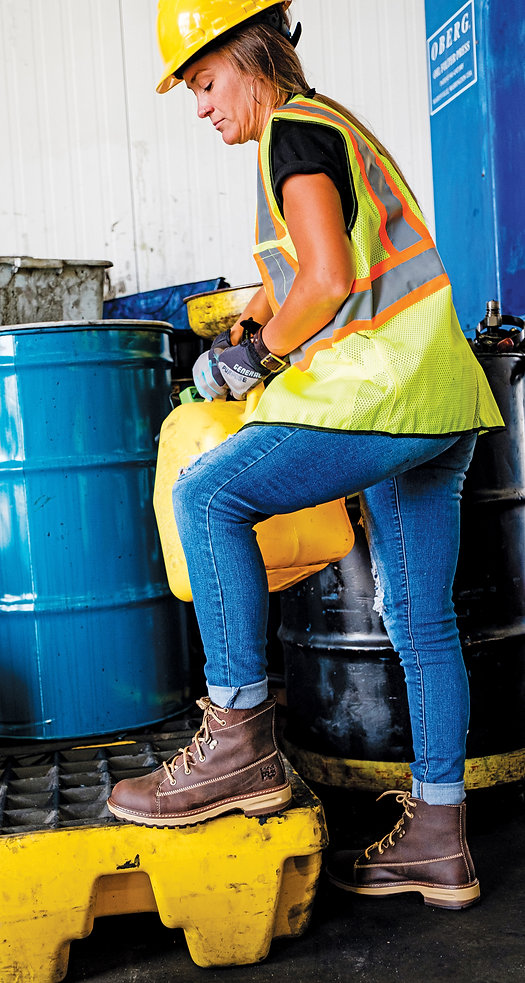 Woman working wearing safety gear and women's safety toe shoes