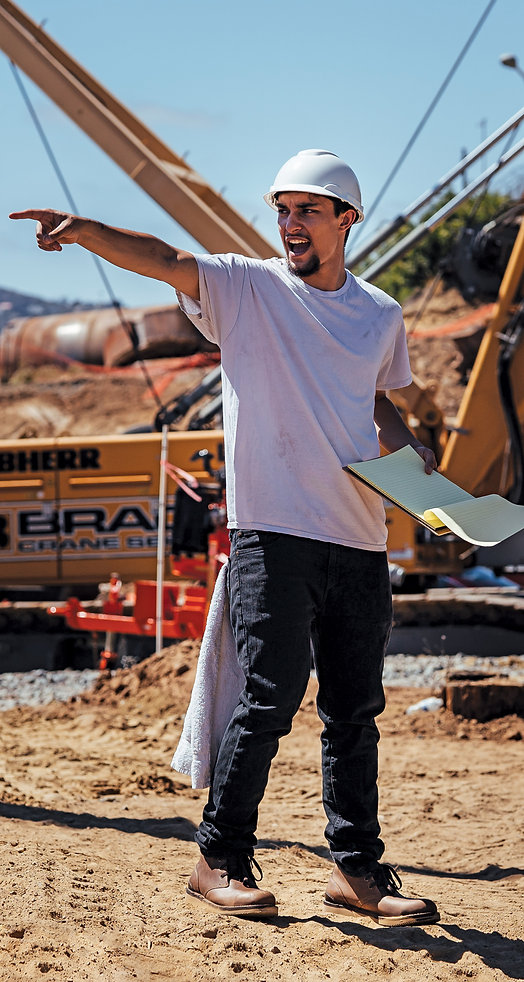 Man working in construction site wearing men's construction boots