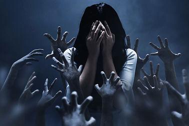Scared woman on dark background.jpg