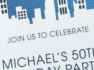 Die cut NYC skyline invitation on 2 layers