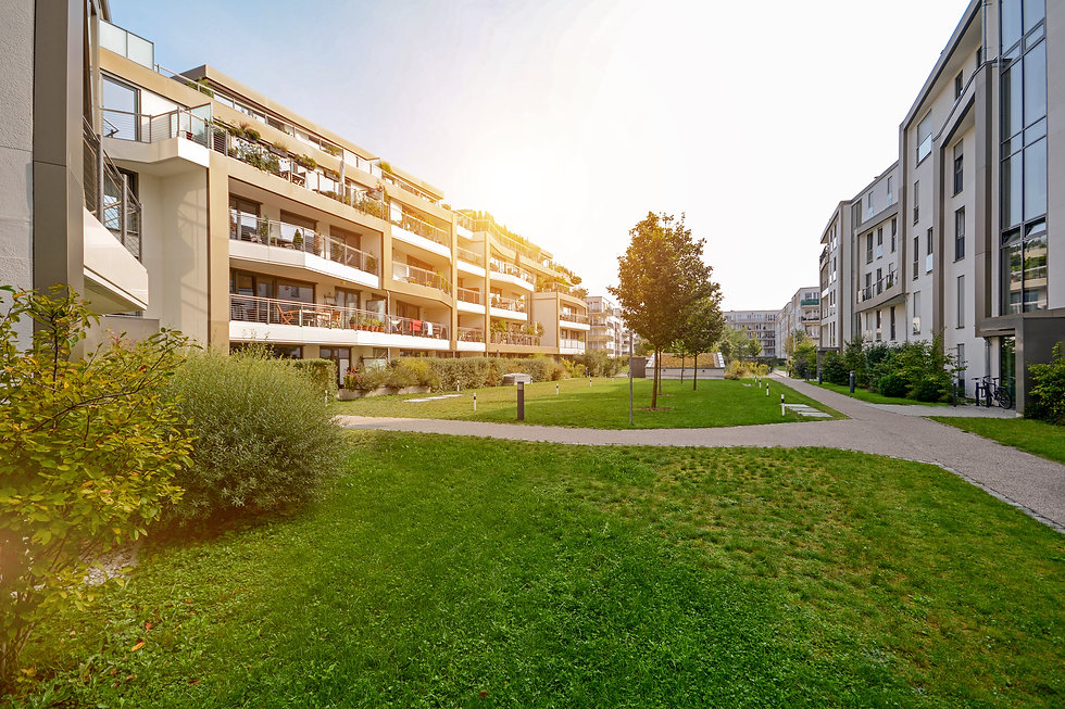 Modern apartment buildings in a green residential area in the city.jpg