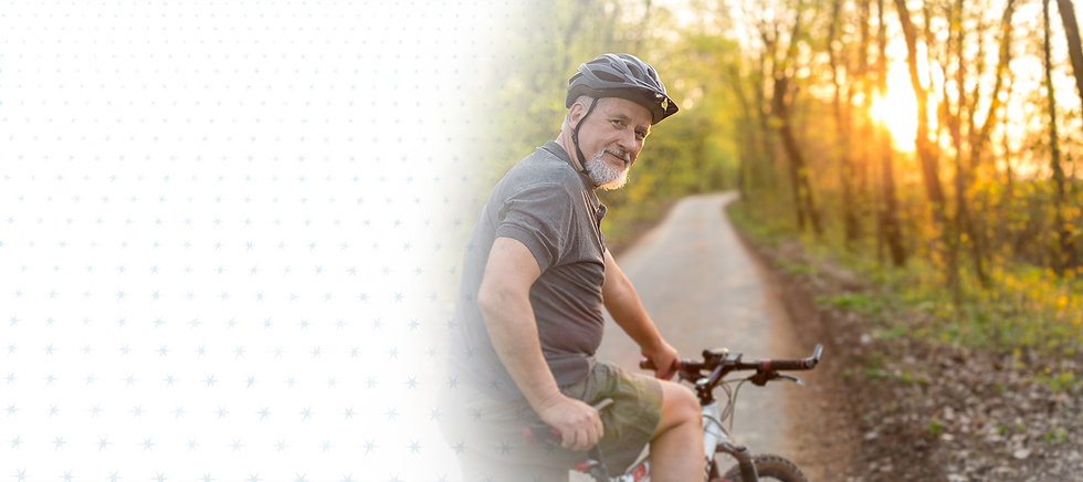 Senior male riding a bicycle