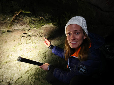 Studying ancient cave carvings in Wemyss