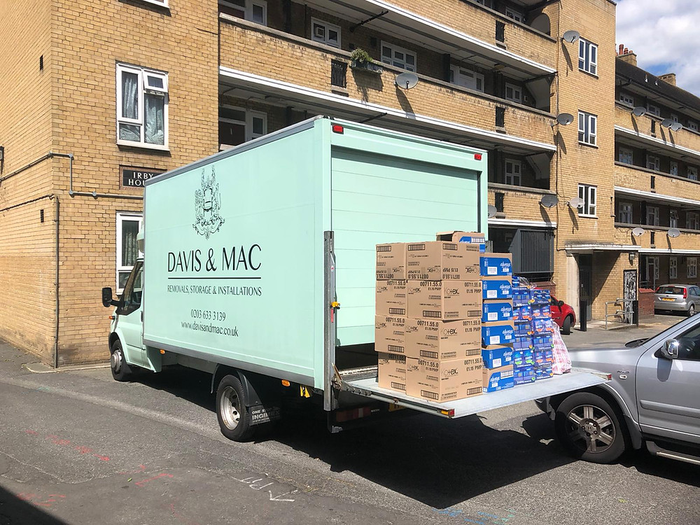 A green van is delivering lots of boxes of period products
