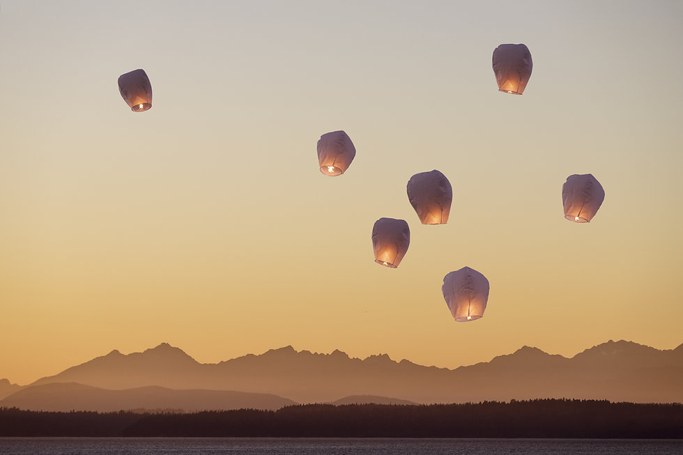 A group of flying lanterns being release