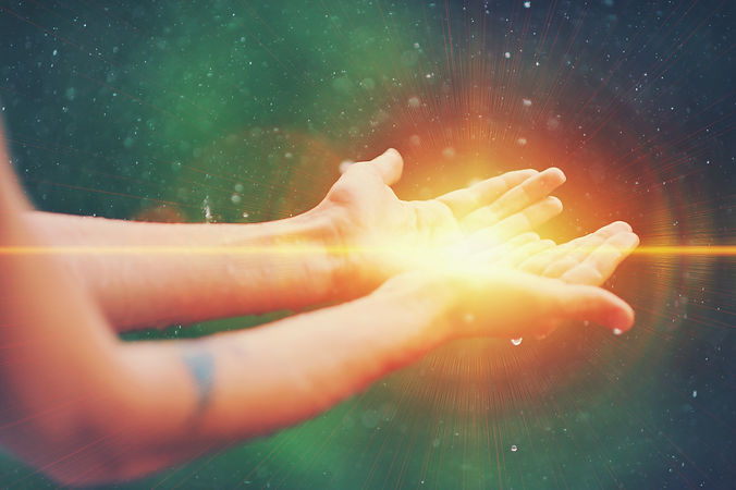 Woman hands praying for blessing from god, blurred nature background, rain, day. Religious