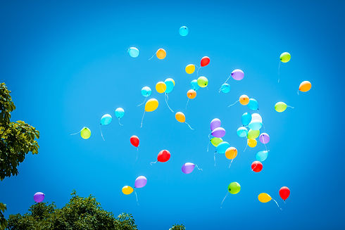 balloons flying in the sky, balloons of different colors soaring in the blue sky, the cele