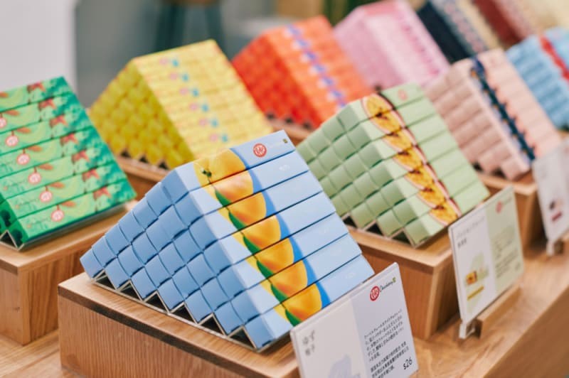 Stacks of KitKat barsd inside the KitKat Chocolatory pop up store, featuring 14 luxurious flavors