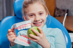 Young girl in a dental chair