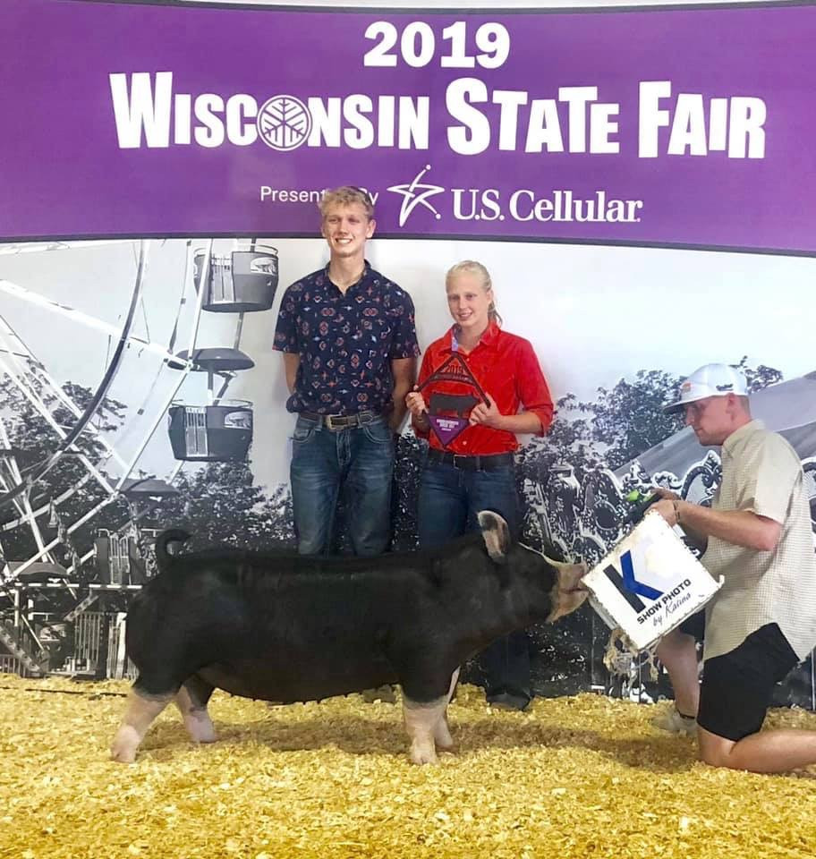 Champion Berkshire Gilt WISCONSIN STATE FAIR GILT SHOW Shown by: Cate Cherney Bred by : Schmaling Bros.Berkshires  Sired by : Non Stop 48-1 (Mauck)