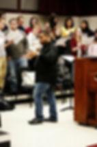 brandon directing choir.jpg