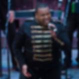 Brandon singing showman look.jpg