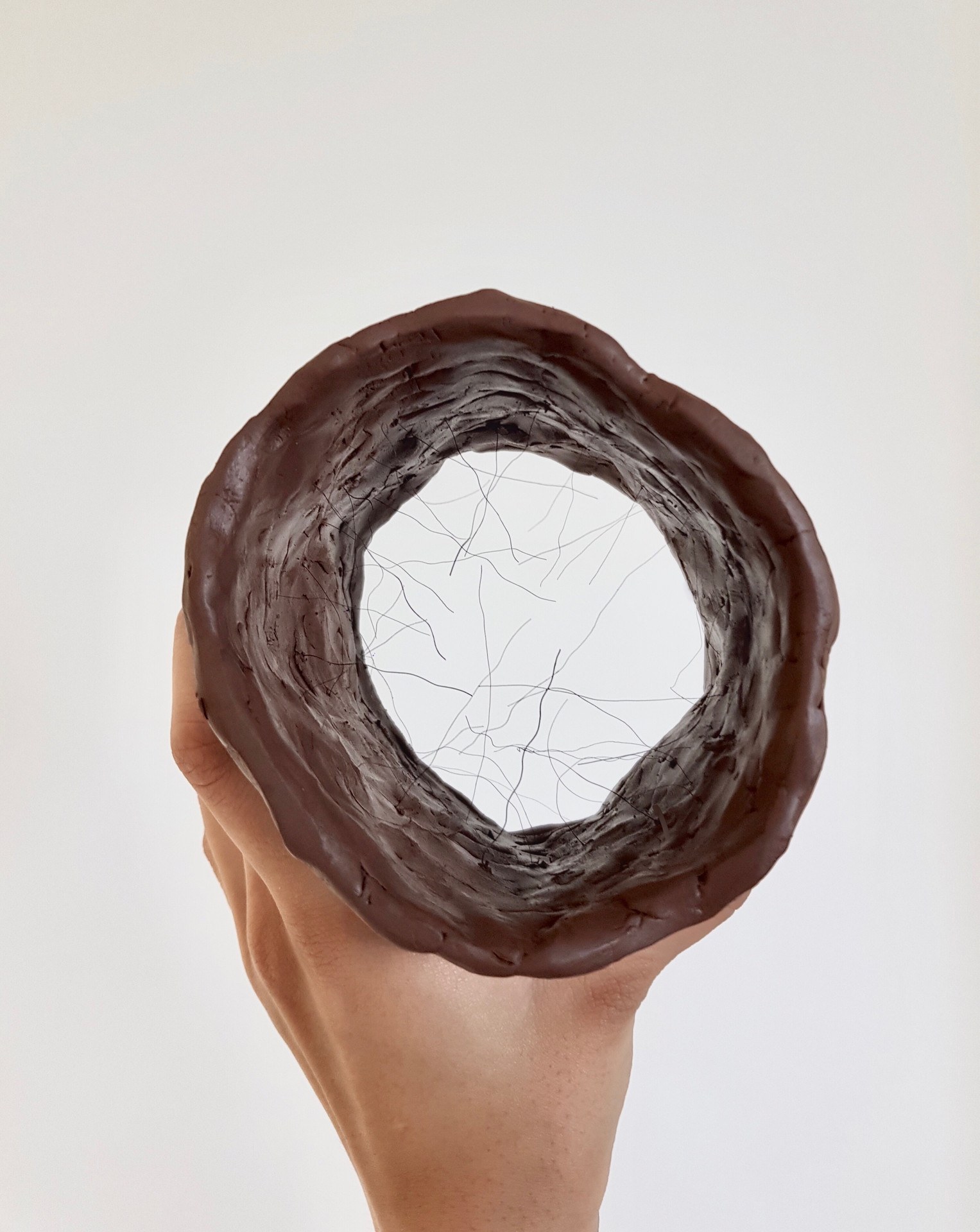 Would you put your hand in?, 2019 (clay, fake hair)