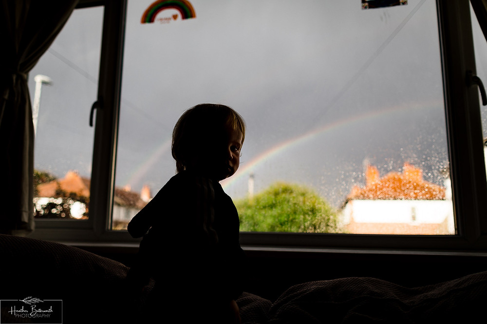A toddler looking out the window after restrictions were slightly lifted after the COVID-19 lockdown in Leeds , Yorkshire in June 2020