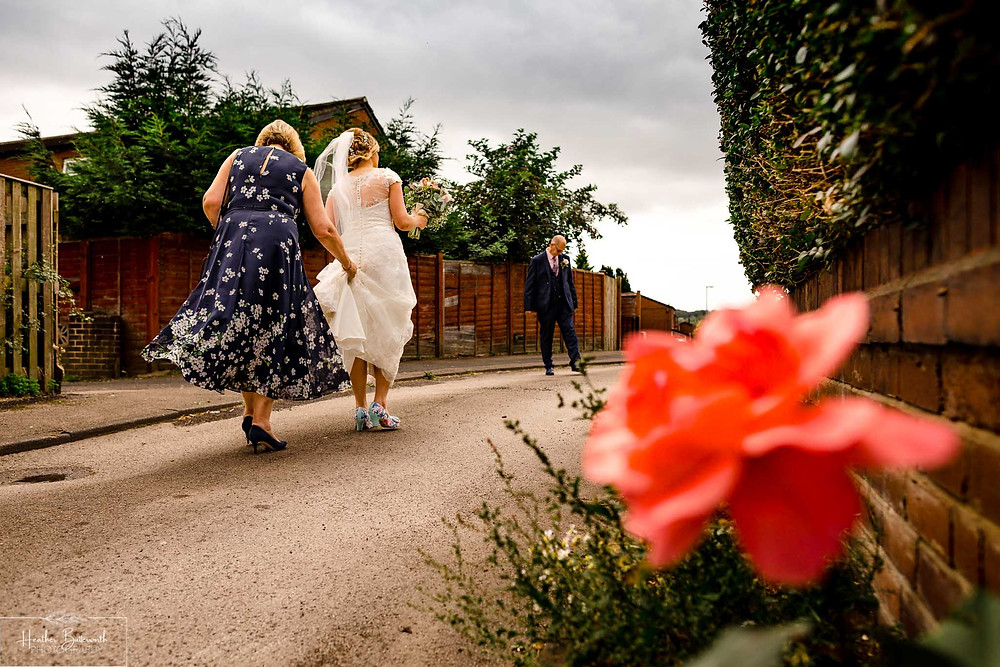 bride with her mother and father on her way to her wedding in Leeds Yorkshire UK in august 2020