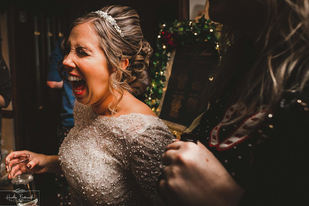 Bride laughing at The Woodman Inn in Thunderbridge, Yorkshire