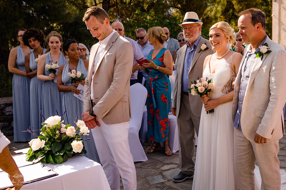 bride walking down the aisle at The Boutzi wedding venue in Skiathos Town in June 2019