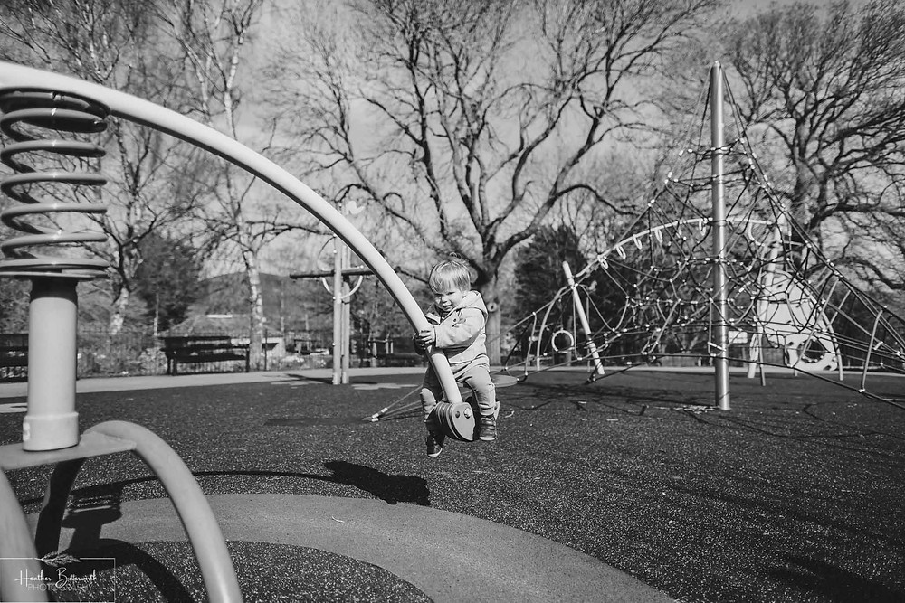 boy playing on the seesaw at the park
