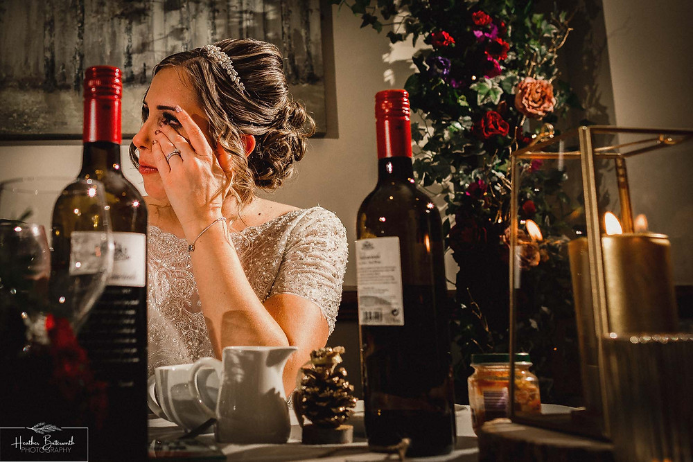 Bride getting emotional during the Grooms speech at The Woodman Inn in Thunderbridge, Yorkshire