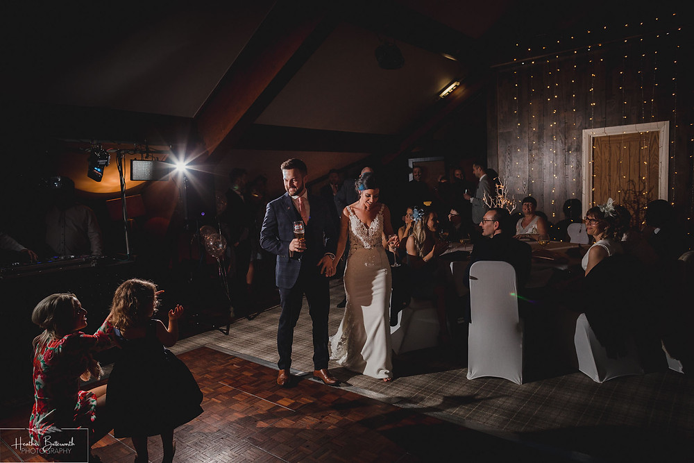 Bride Bex and Groom Andy arriving at their evening reception at The Burnside Hotel and Spa in Bowness-on-Windermere