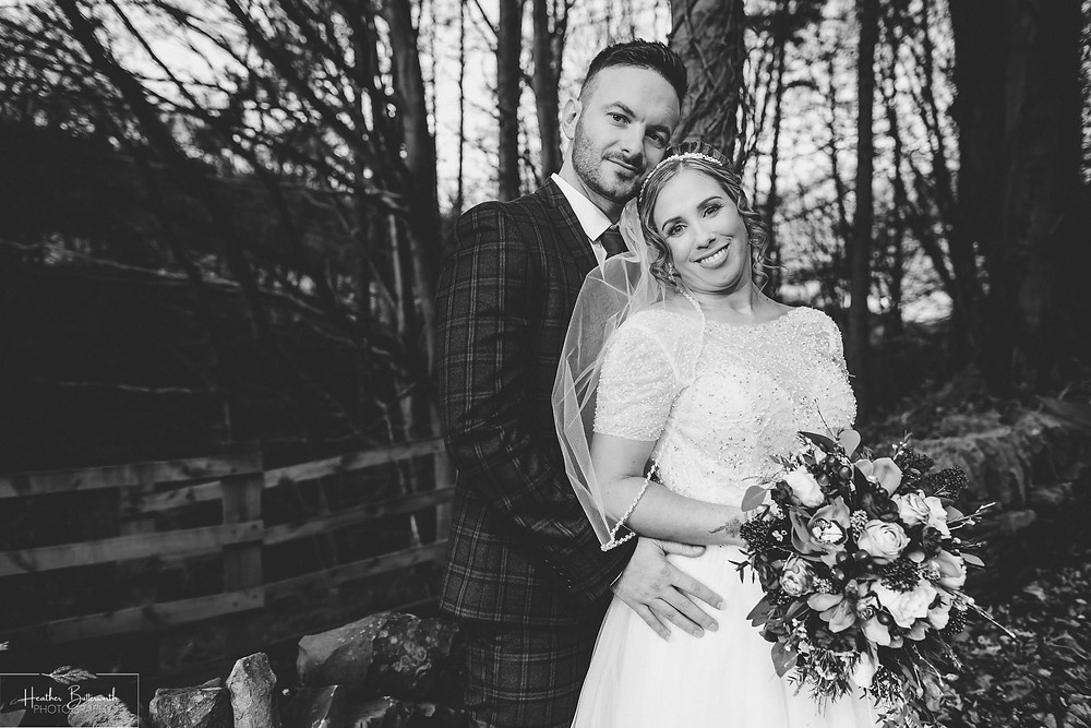 Bride and groom in the woods after their wedding ceremony at The Woodman Inn in Thunderbridge, Yorkshire