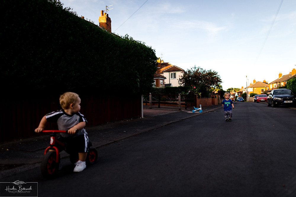 children playing and social distancing in the street after the COVID lockdown in June 2020 in Leeds Yorkshire