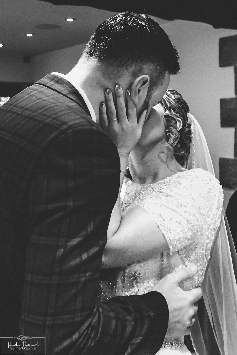 Bride and Groom kissing during their wedding ceremony at The Woodman Inn in Thunderbridge, Yorkshire