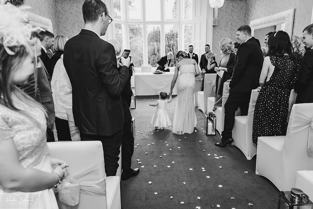 Bridesmaids walking down the aisle at The Burnside Hotel and Spa in Bowness-on-Windermere