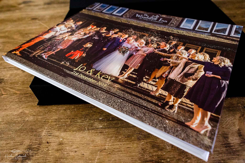 wedding album on a wooden table by Heather Butterworth photography