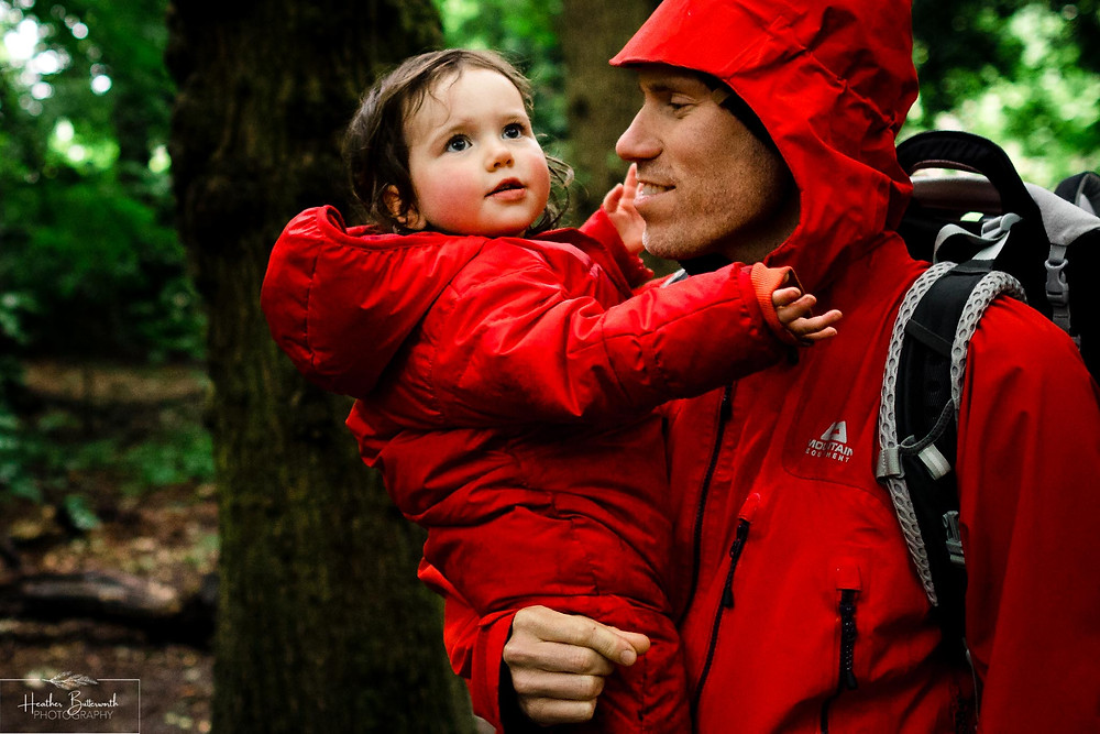 father and daughter in roundhay park woods after restrictions were slightly lifted after the COVID-19 lockdown in Leeds , Yorkshire in June 2020
