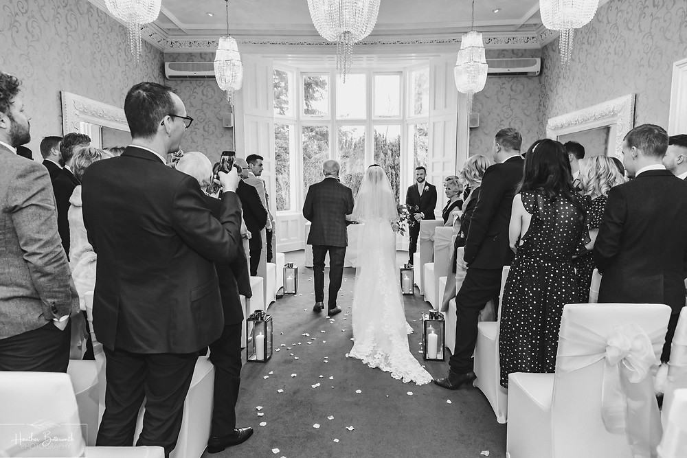 Bride Bex and her dad walking down the aisle at The Burnside Hotel and Spa in Bowness-on-Windermere