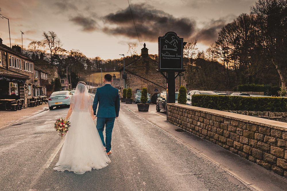 bride and groom walking down the road at the woodman inn in Yorkshire in December 2019