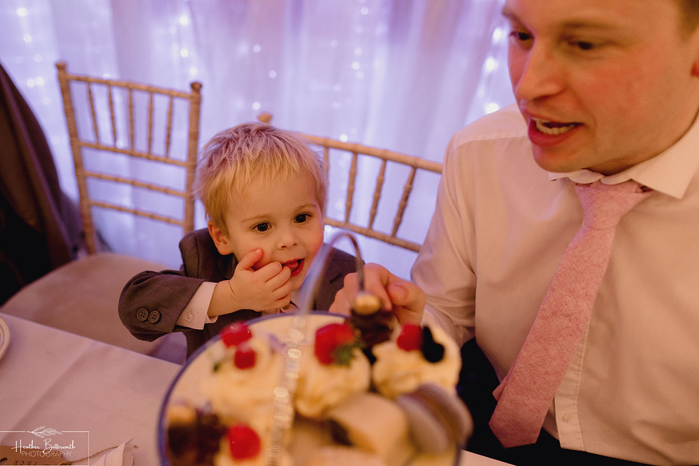 leeds wedding photographer Yorkshire reception alwoodley community hall page boy cake